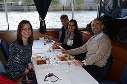 The group is dining on the River Thames